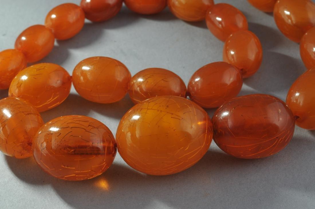 Set of graduated amber beads. Honey colored. - 3