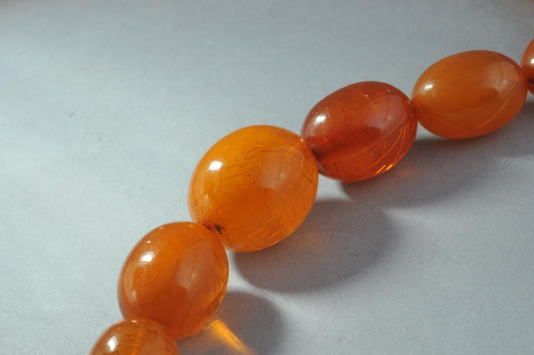 Set of graduated amber beads. Honey colored. - 5