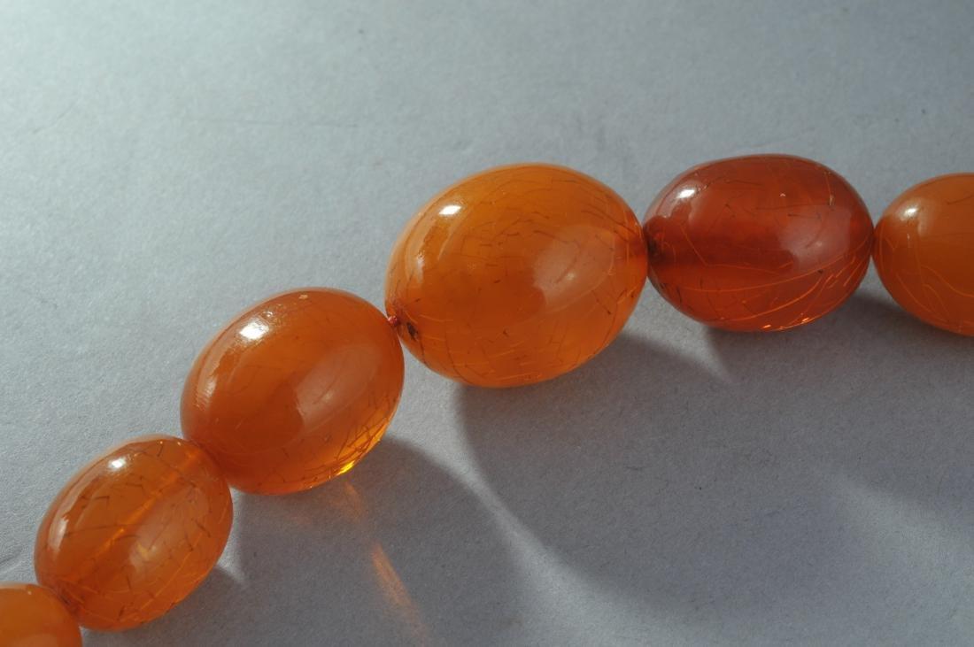 Set of graduated amber beads. Honey colored. - 6