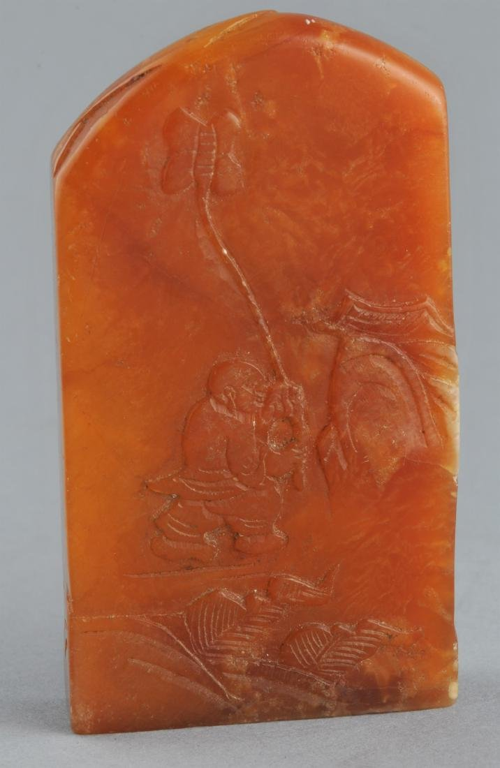 Soapstone seal. Honey coloured stone surface carved