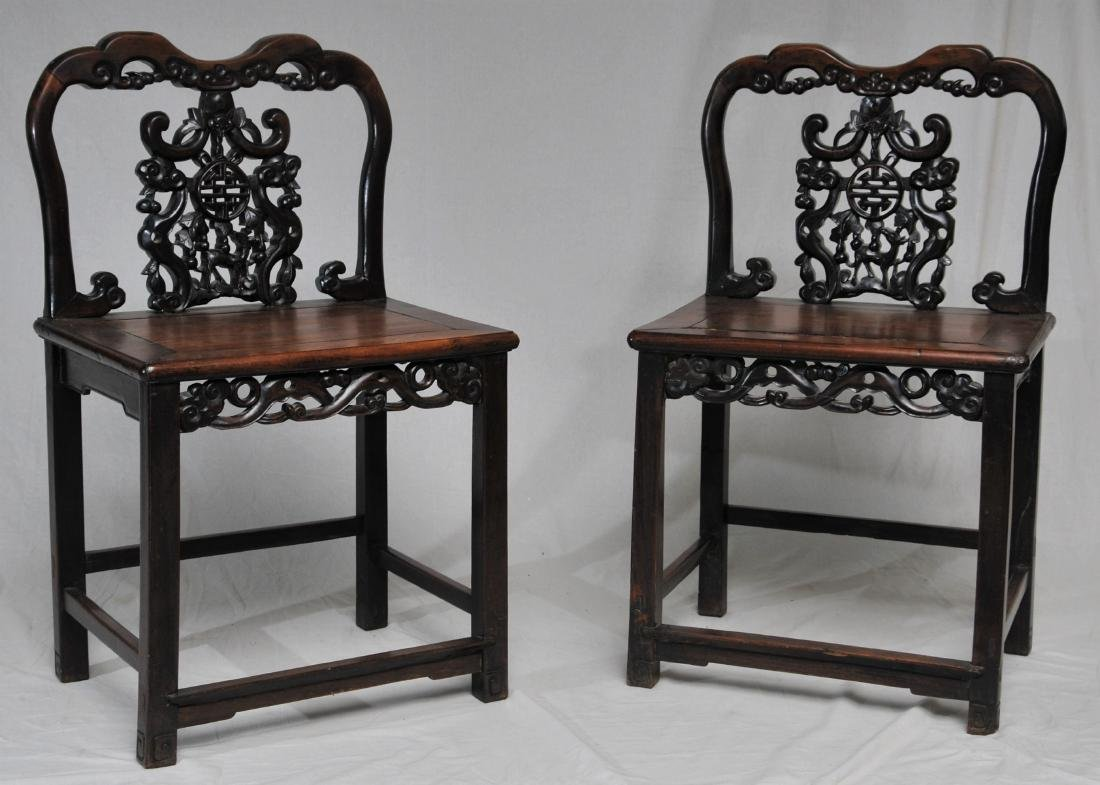 Pair of side chairs. China. 19th century.  Carved back