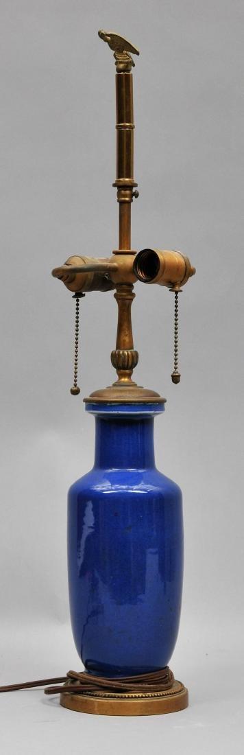 Porcelain vase. China. 19th century. Roleau form. Blue