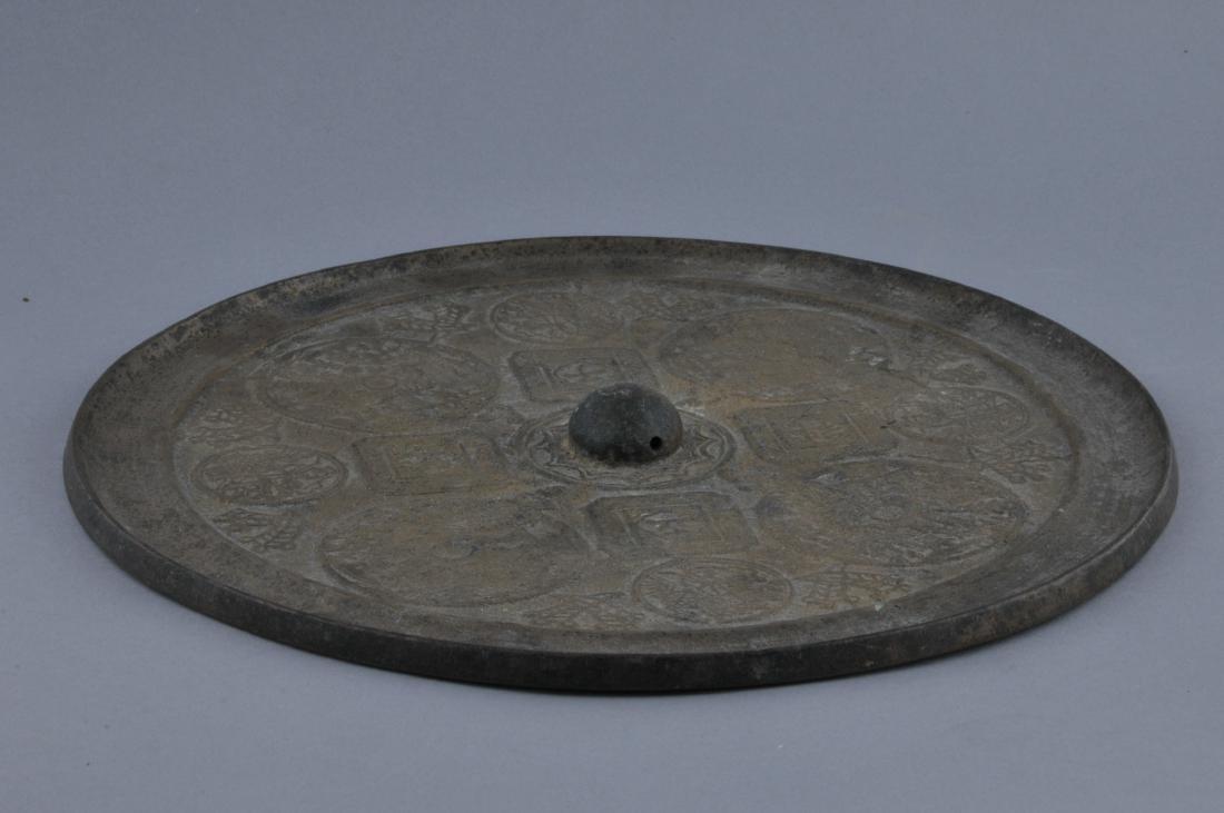 Bronze mirror. China. 18th century. Cast decoration of - 8