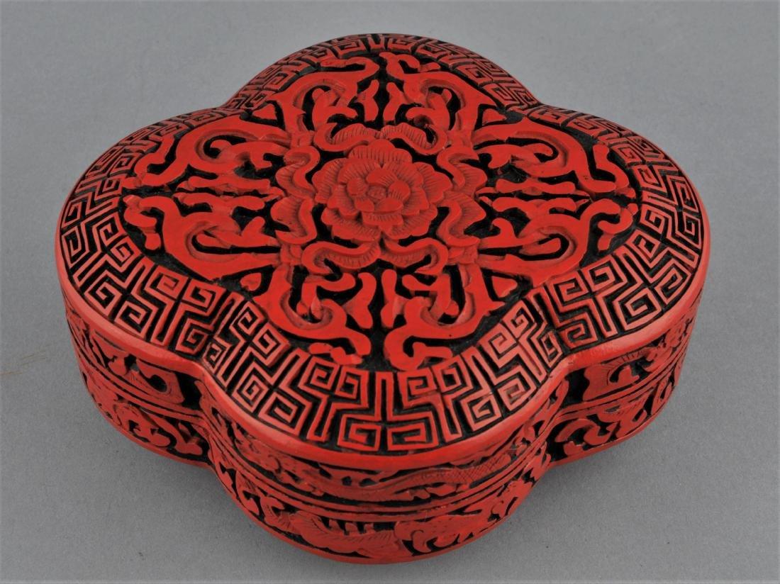 Cinnabar lacquer box. China. 20th century. Quatrefoil