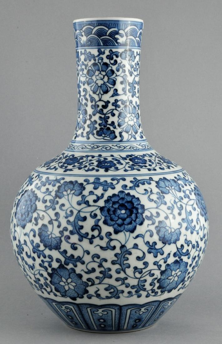 Porcelain vase. China. 20th century. Bottle form.
