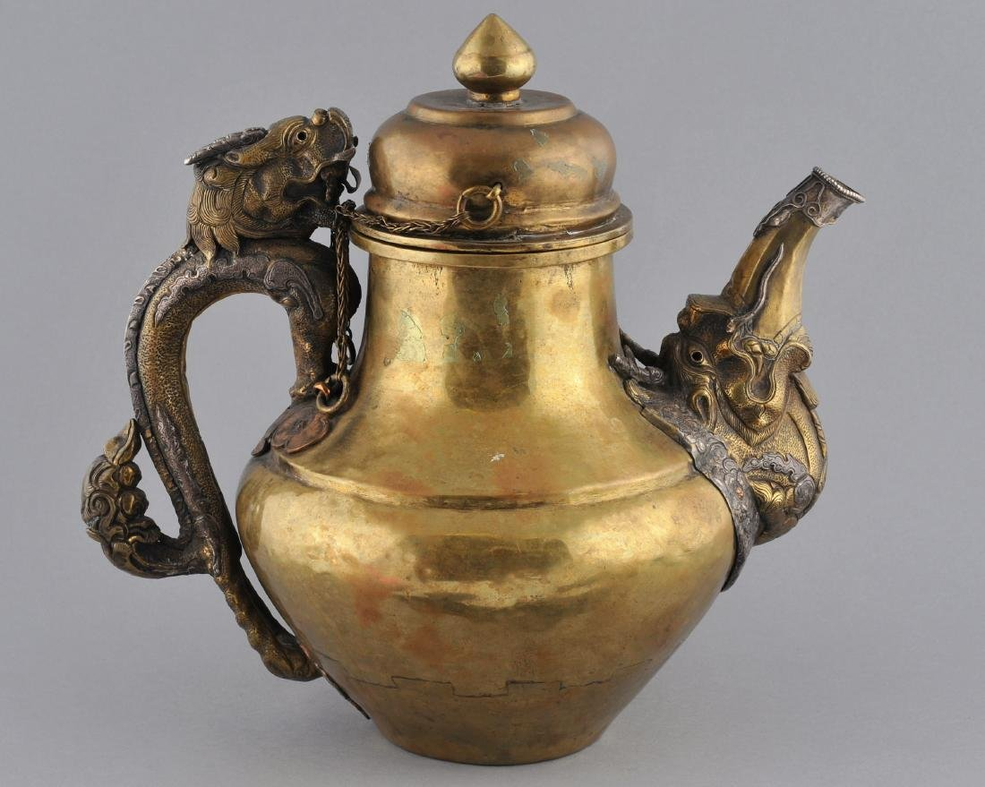 Teapot. Tibet. 19th century. Brass body with silver