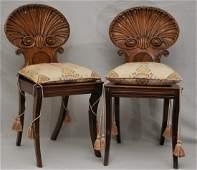 Pair of English Regency period carved mahogany shell