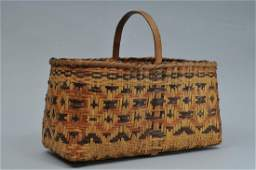 Large early Cherokee handled basket of woven reed with