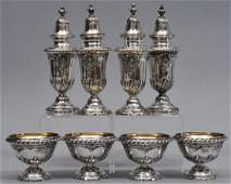 Set of eight heavy sterling silver salt sets. Four tall