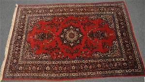 Semi-Antique Persian Kashan carpet. Deep rust color