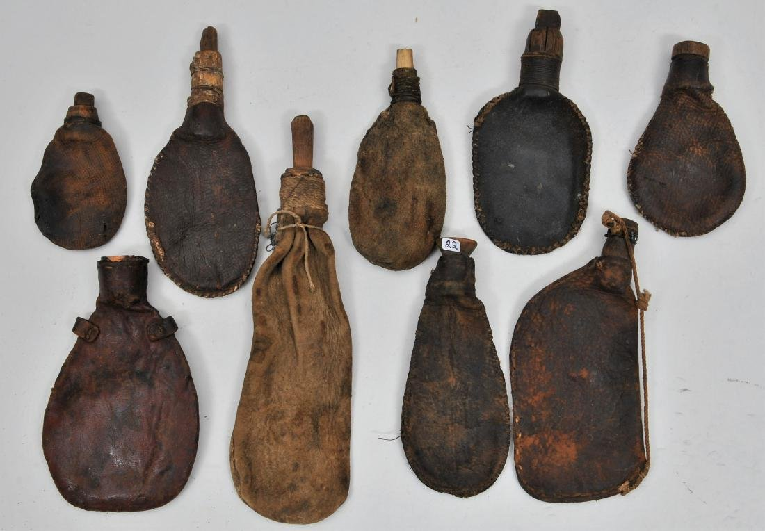 Lot of nine early leather shot bags. Eight of them have