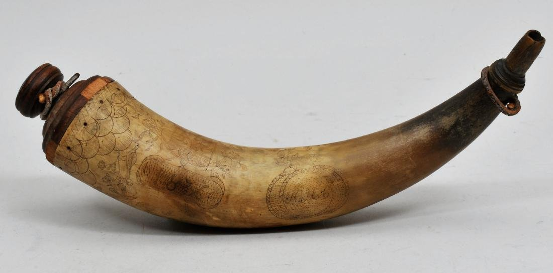 "12"" Powder horn. This horn is elegantly engraved and"