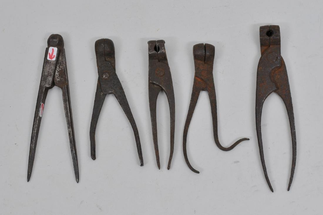 Lot of five items which includes four bullet moulds and