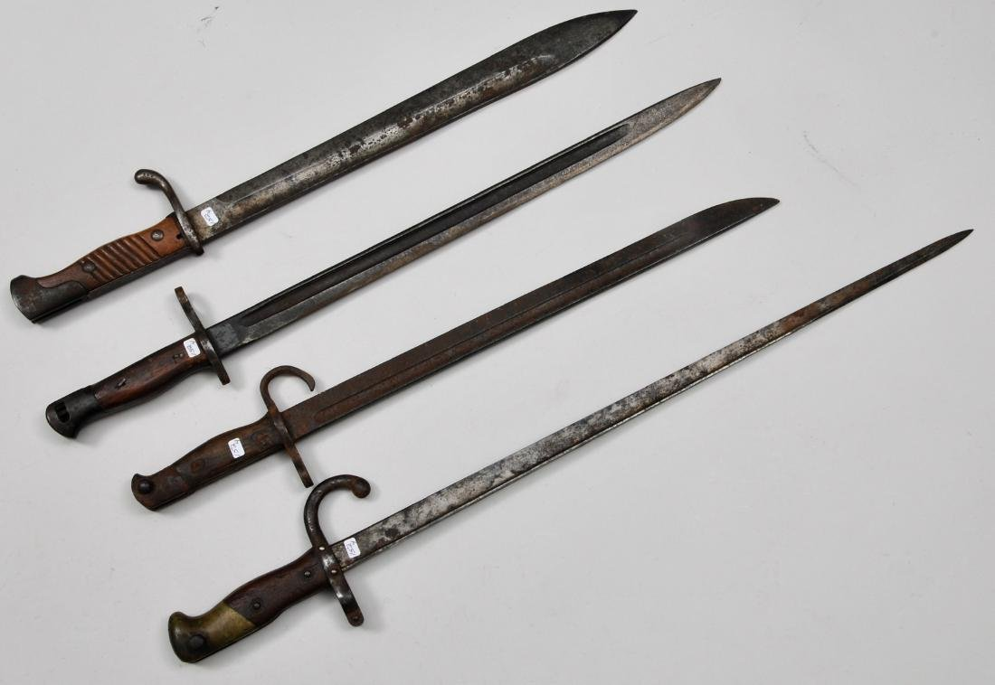 Lot of four bayonets. All appear to be World War I era.