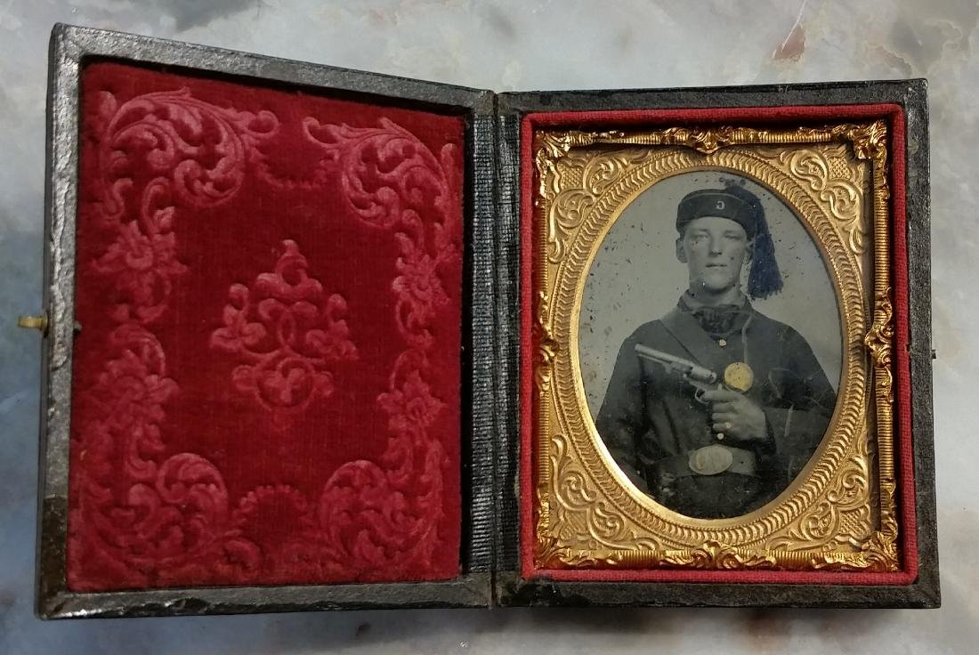 Civil War Ambrotype of a young soldier holding revolver