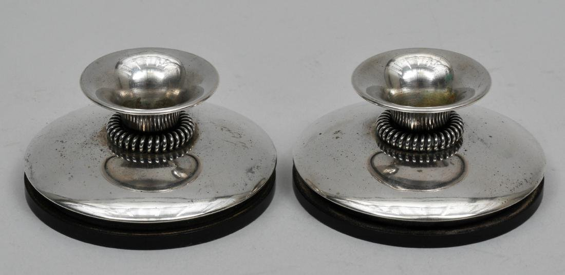 Pair of MCM silver small candlesticks with openwork