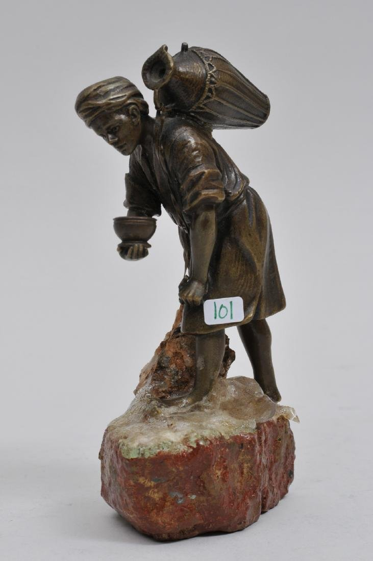 A. Titze bronze sculpture of an Arab man with a water