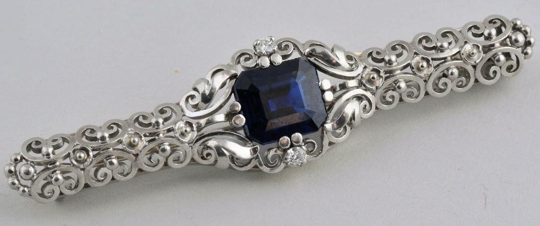 18k white gold, sapphire, and diamond brooch pin. Early