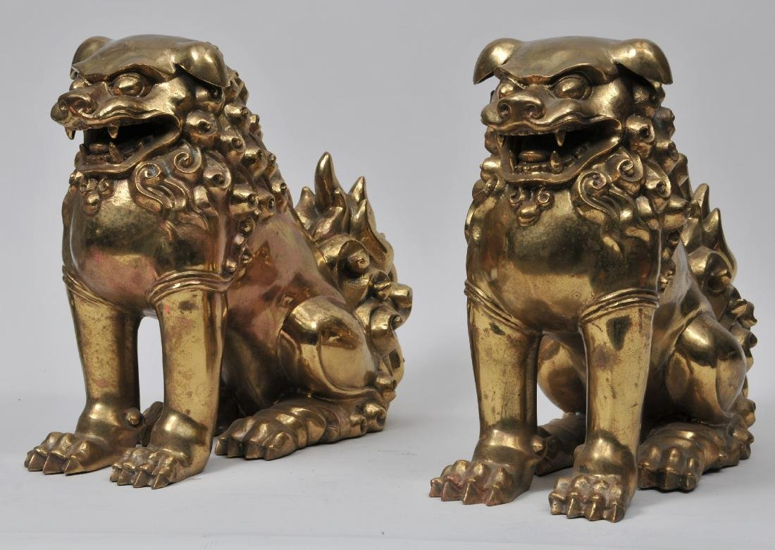 Pair of 20th century gilt bronze Chinese foo lions.