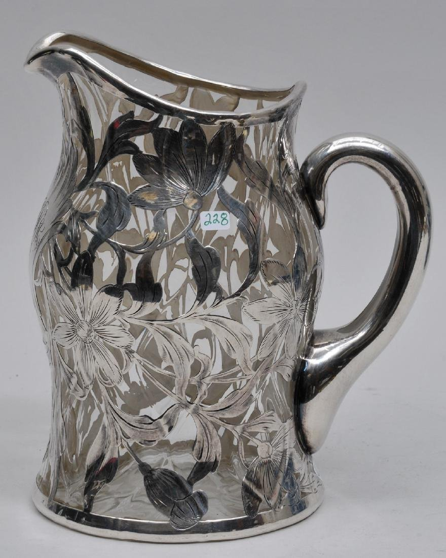 Antique silver overlay clear glass pitcher. Fine floral