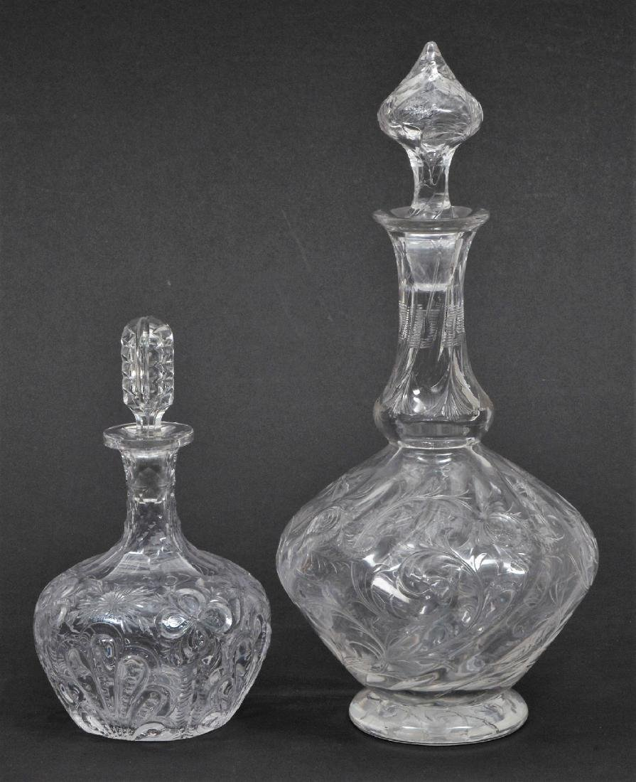 Two rock crystal type cut glass bottles. (1) Hawkes