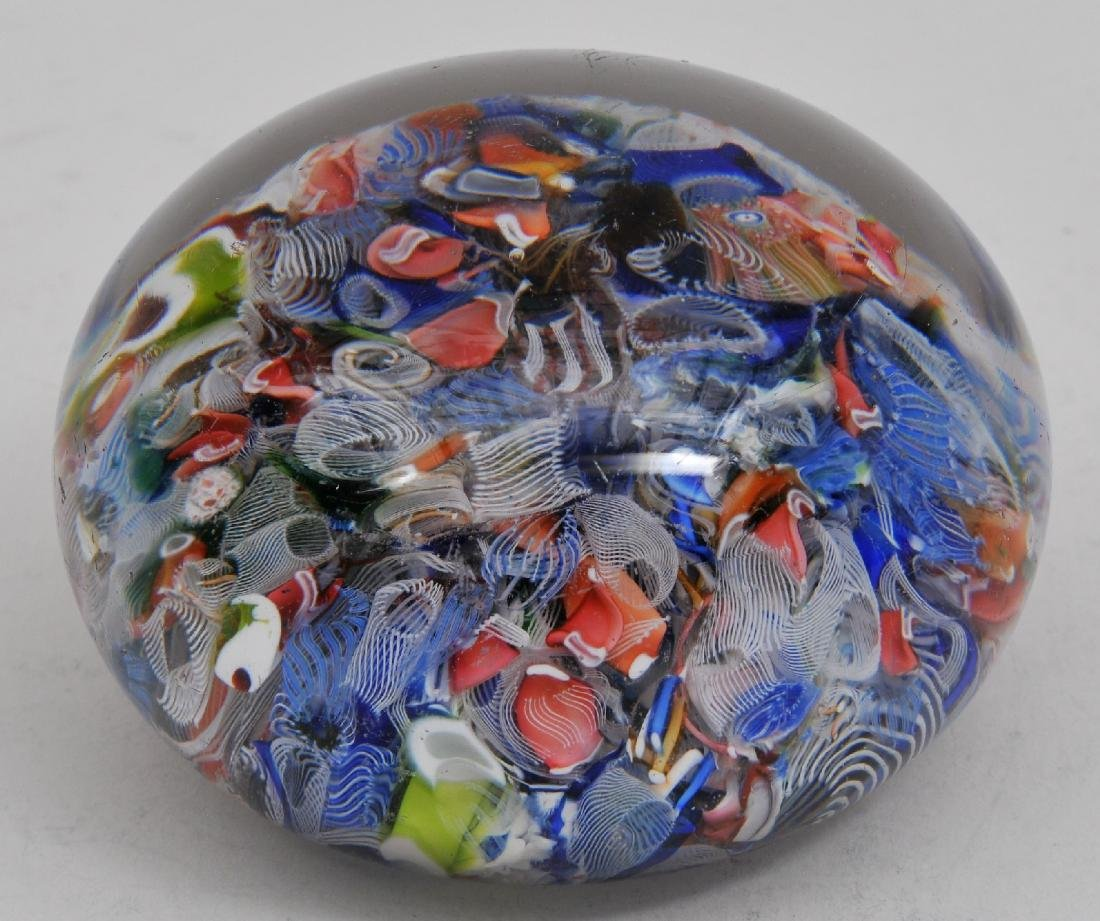 Antique scrambled glass paperweight. Wear to base.