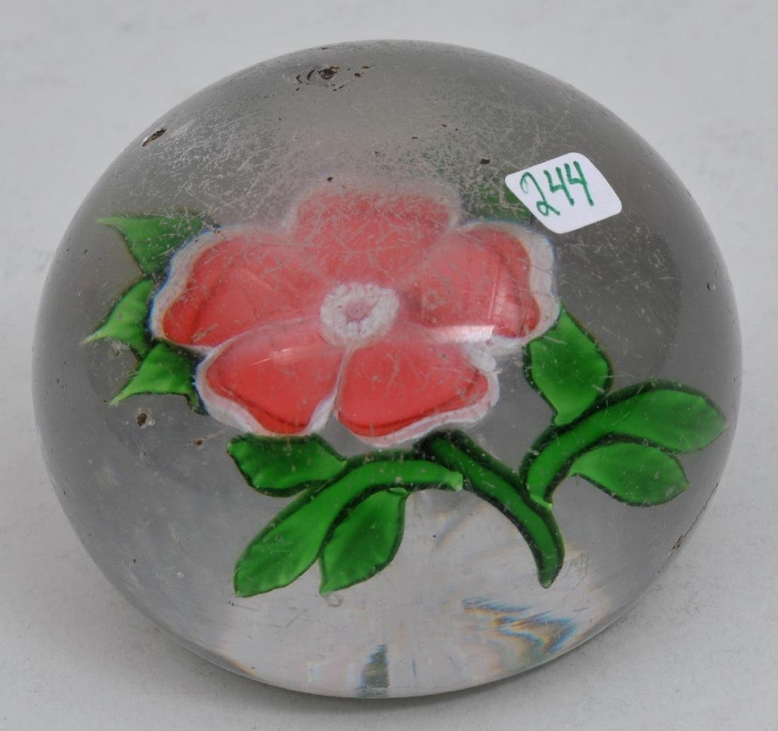 Antique red flower glass paperweight with small star