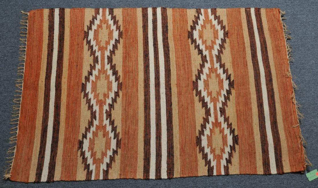 Vintage Rio Grande style carpet. Wood rod for hanging.