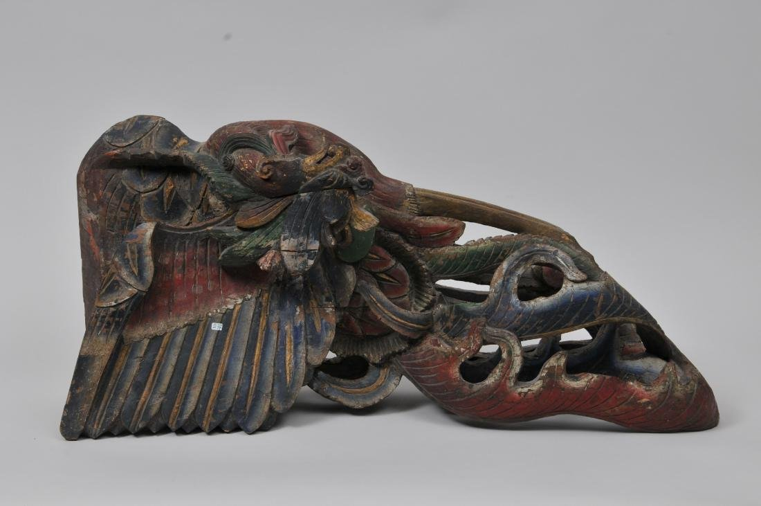 "Asian paint decorated Phoenix bird  carving. 14"" x 30""."