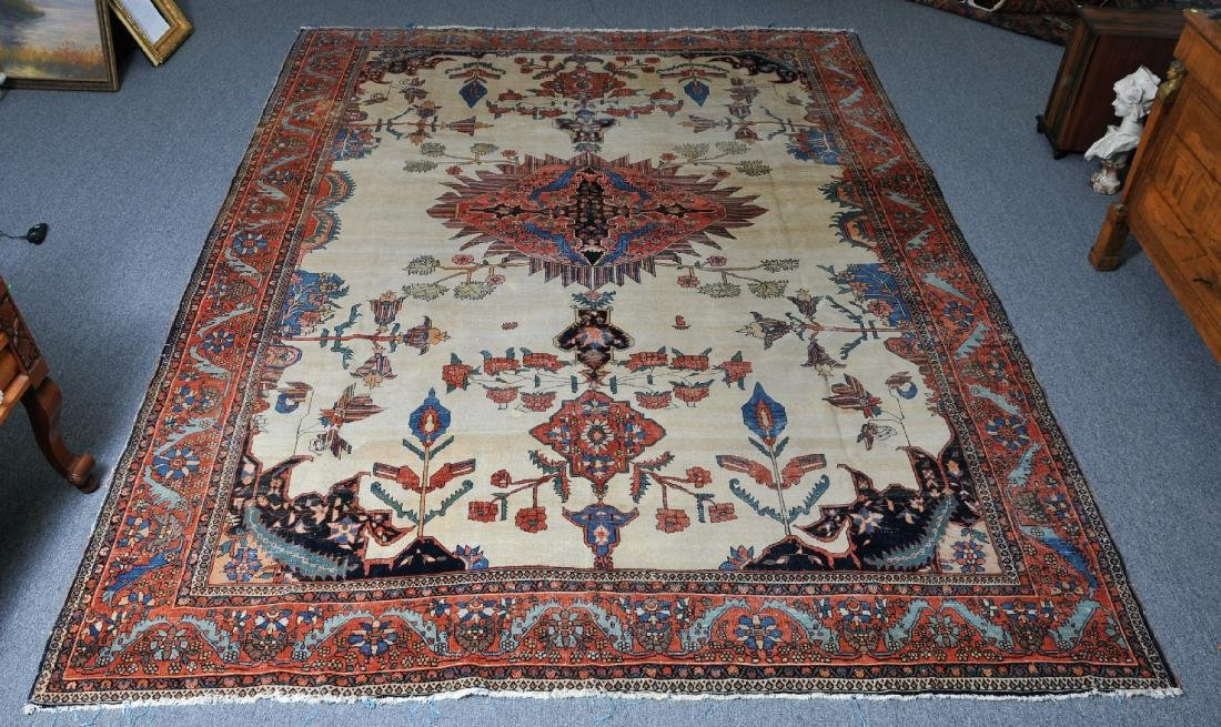 Antique Ivory field room size Sarouk carpet. Ivory