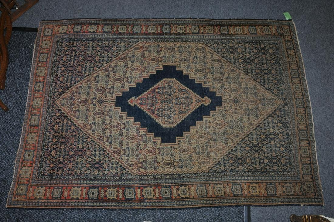 Antique Persian Sena scatter size carpet with a blue