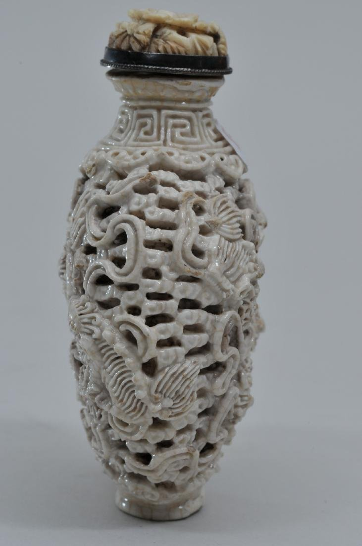 Snuff bottle. 19th century. White porcelain carved with - 3
