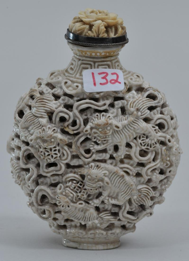 Snuff bottle. 19th century. White porcelain carved with - 4