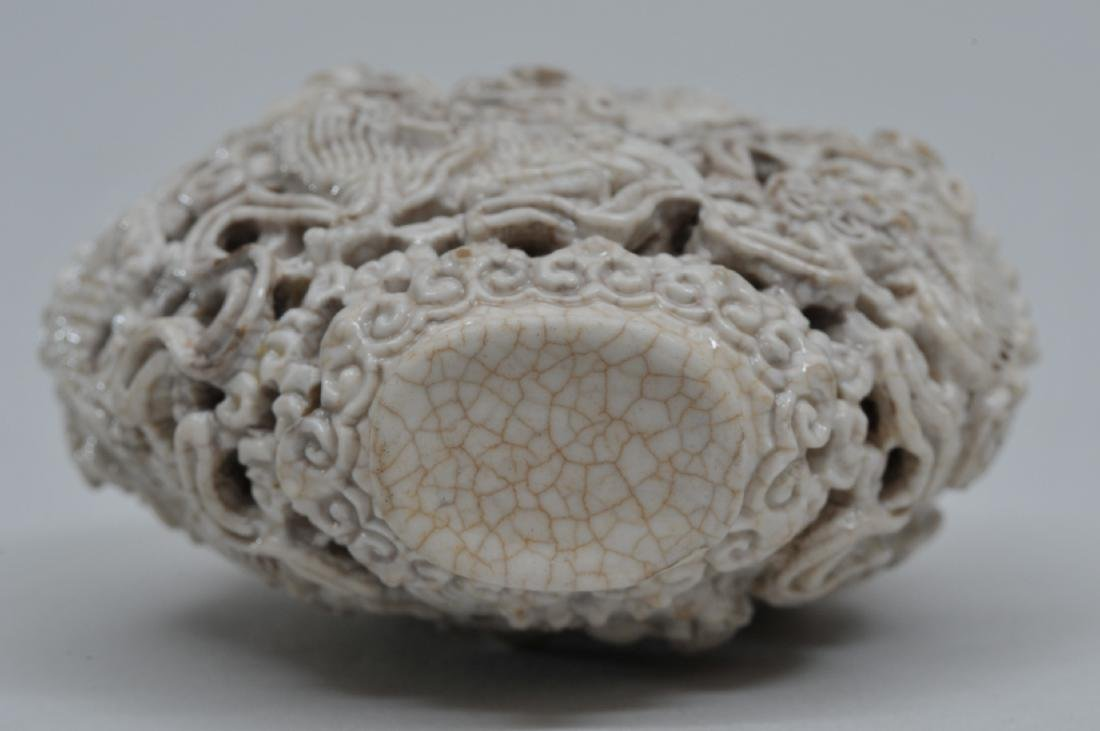 Snuff bottle. 19th century. White porcelain carved with - 6