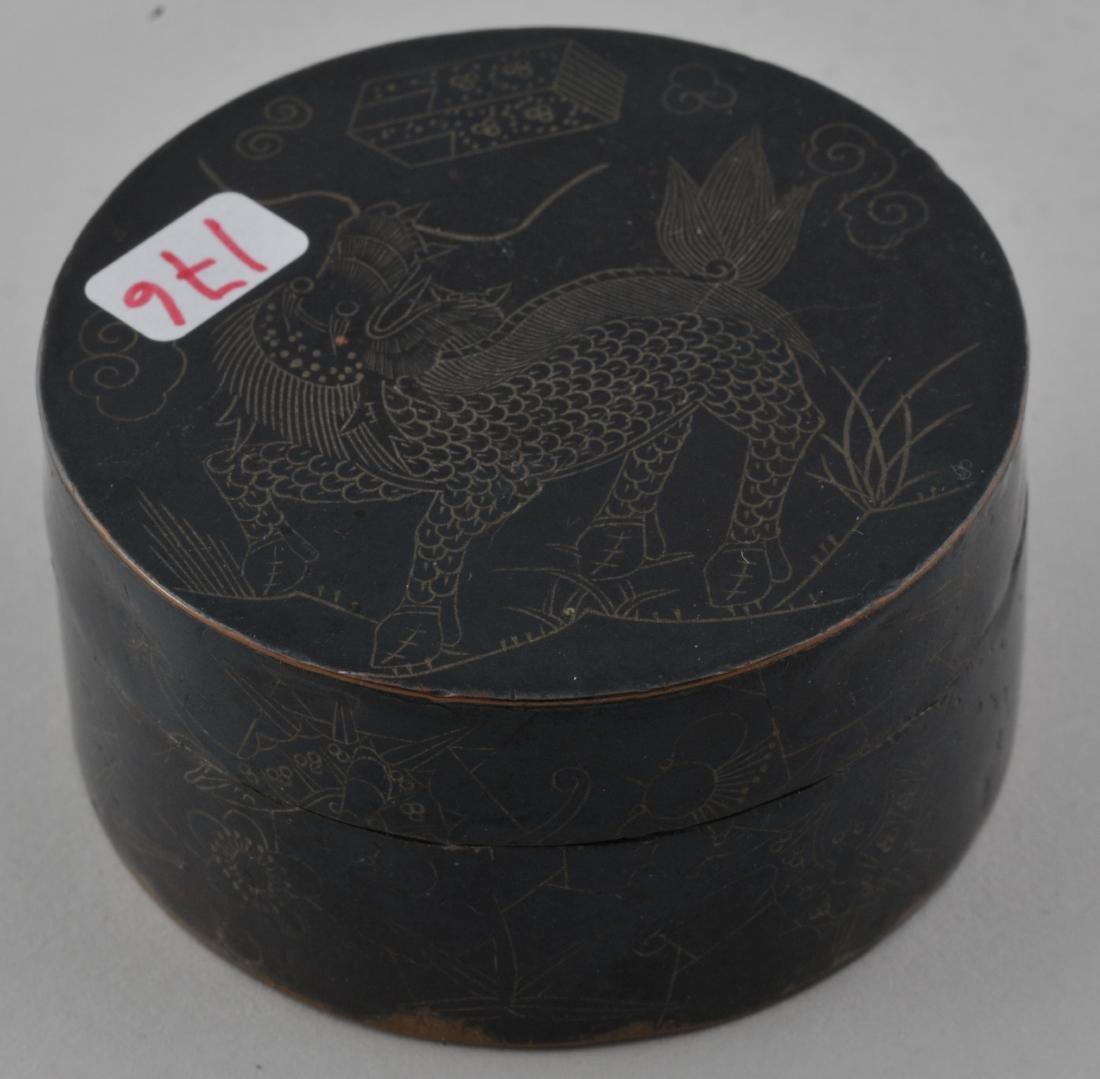 Round copper box. China. 19th century. Blackened