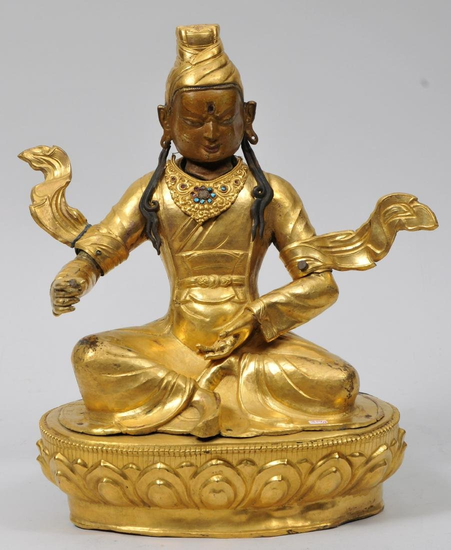 Repousse gilt copper image. Tibet. 19th century. Seated