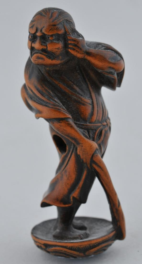 Wooden Netsuke. Japan. 19th century. Standing figure