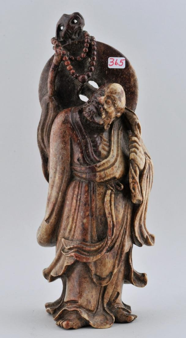 Soapstone carving. China. 19th century. Standing figure