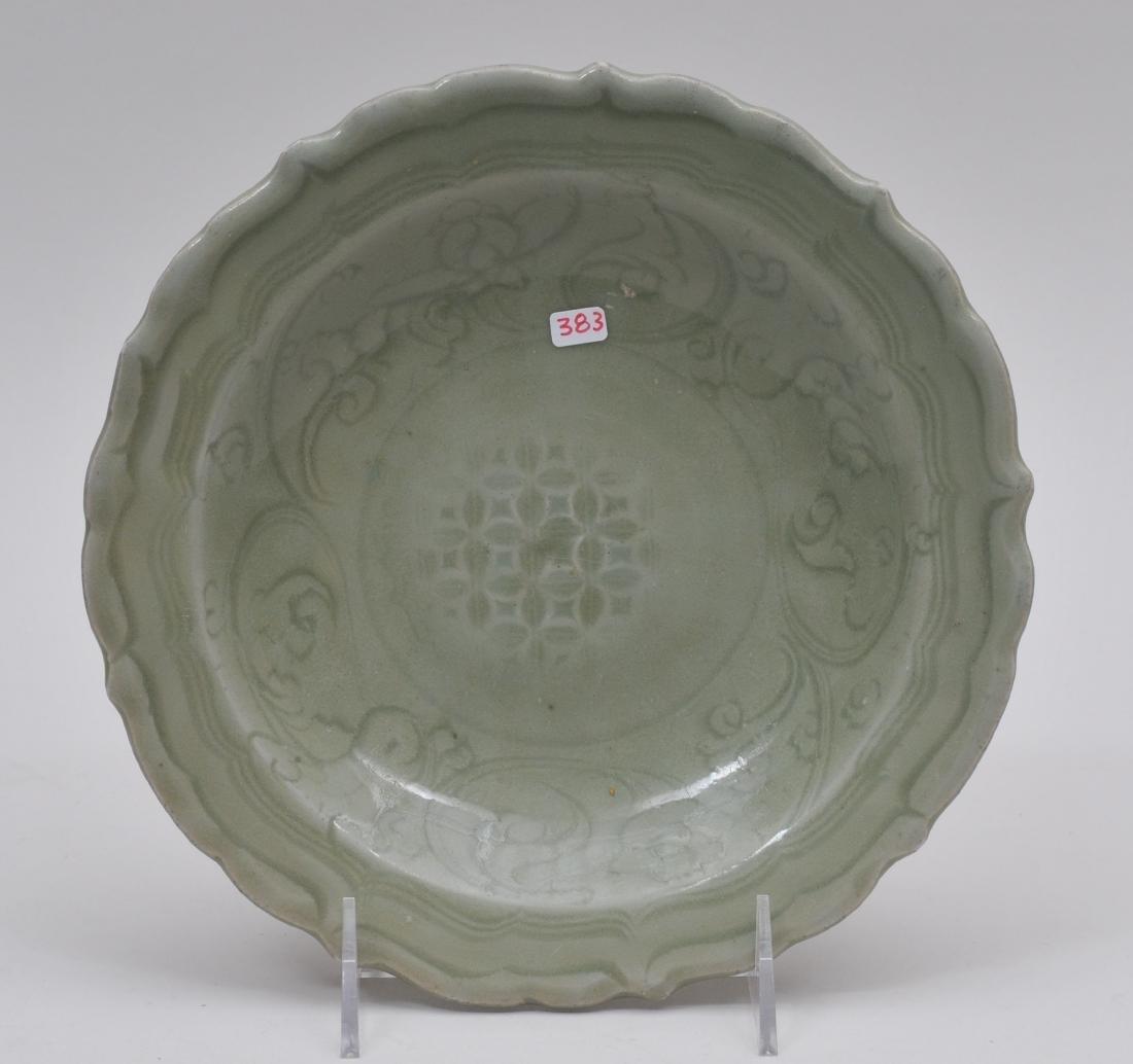 Celadon dish. China. Ming period. (1368-1644). Foliate