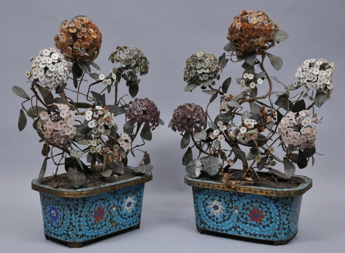 Pair of planters. China. 19th century. Cloisonne bases