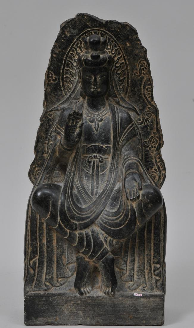 Carved stone Buddha. China. 19th century or earlier.