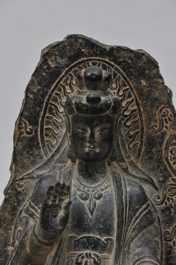 Carved stone Buddha. China. 19th century or earlier. - 2