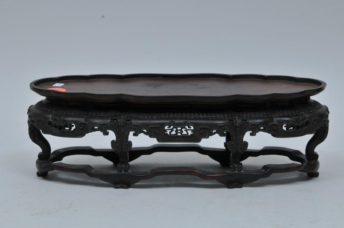 Hardwood stand. China. 18th century. Oval form with
