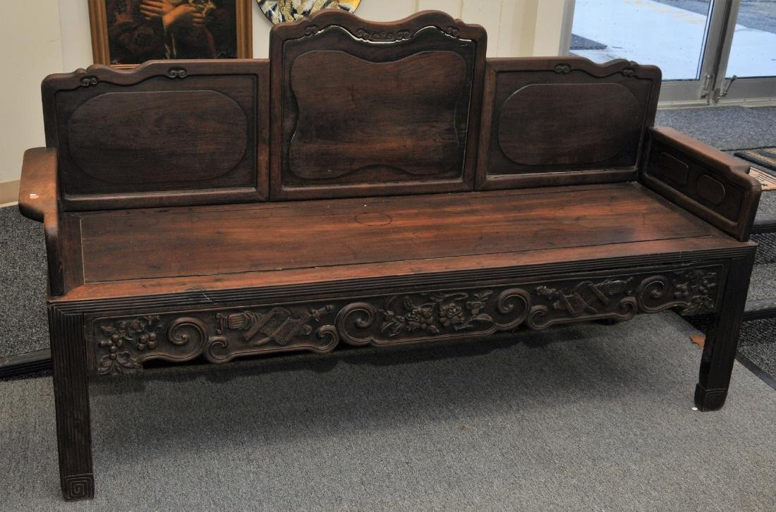 Rosewood couch. China. 19th century. Surfaces carved