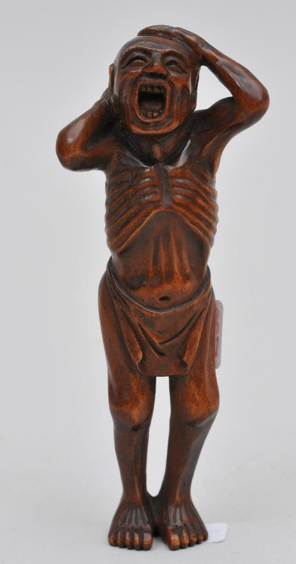 Wooden Netsuke. Japan. 19th century. Man yawning.