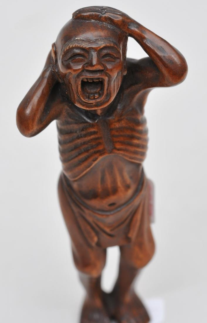 Wooden Netsuke. Japan. 19th century. Man yawning. - 2