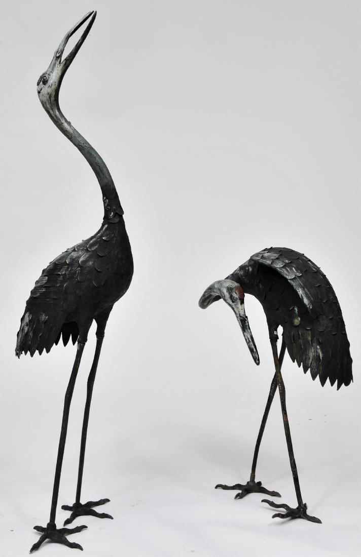 Pair of Bronze cranes. China. 19th century. Paint