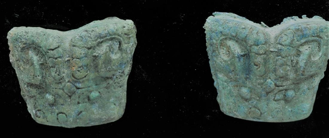 Pair of bronze fittings. China. Probably Chou period. - 2