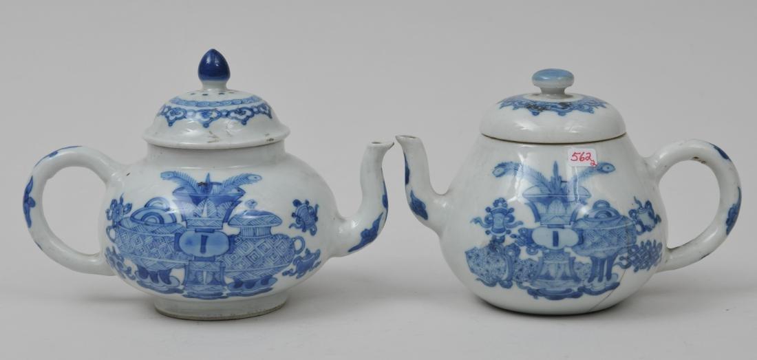 Two porcelain teapots. China. 19th century. Underglaze