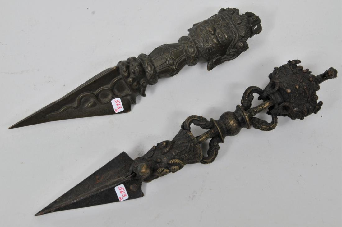 Two bronze ritual knives. Tibet. 19th century. Phurbas